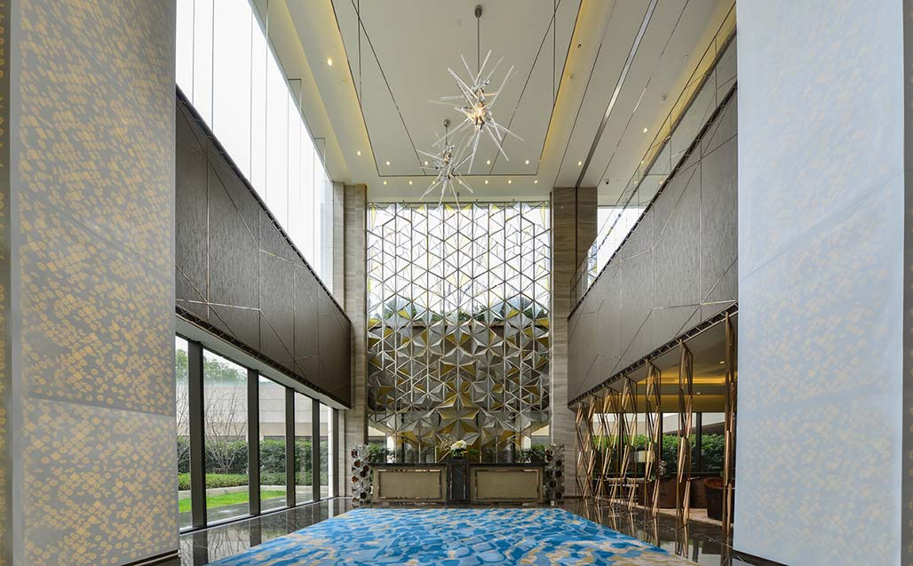one park shanghai by wilson associates, a luxury building with krion® in its hall. Solid Surface para casas