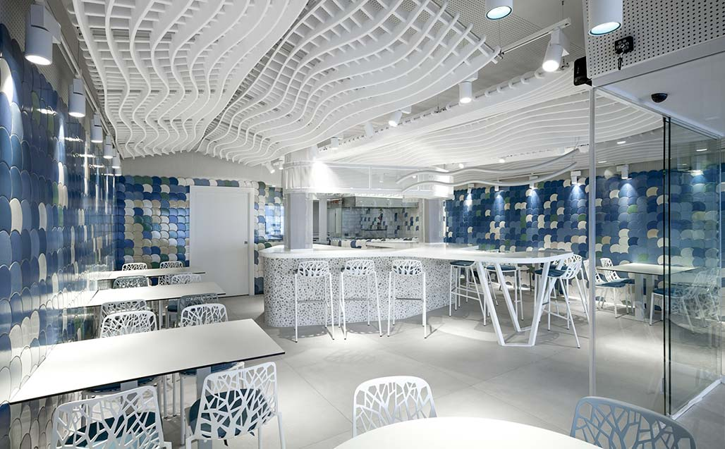 the escalar studio uses krion to prolong the divide between the blues of the water and the sky at drassana medbar . Solid Surface for restaurant & catering