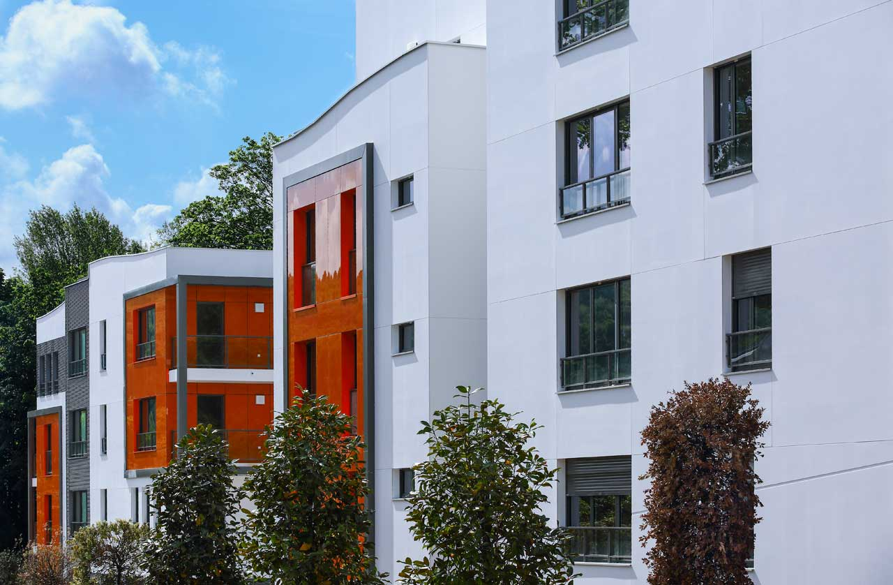 fachada edificio residencial - neudon - francia. Solid Surface for outdoor wall